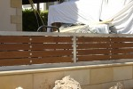 STAINLESS STEEL OR STEEL RAIL WITH SURFACE FROM WOOD
